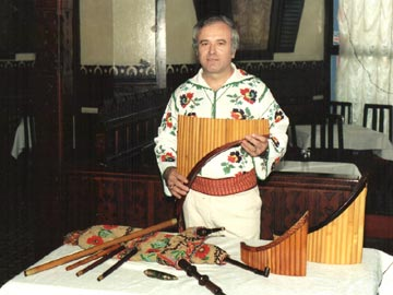 Alexandru Ozon and his instruments: pan pipes, flute, pipe, ocarina and bagpipes.